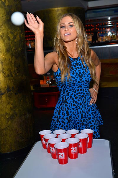 Carmen Electra enjoying a game of beer pong